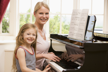 claire_giving_a_student_a_piano_lesson