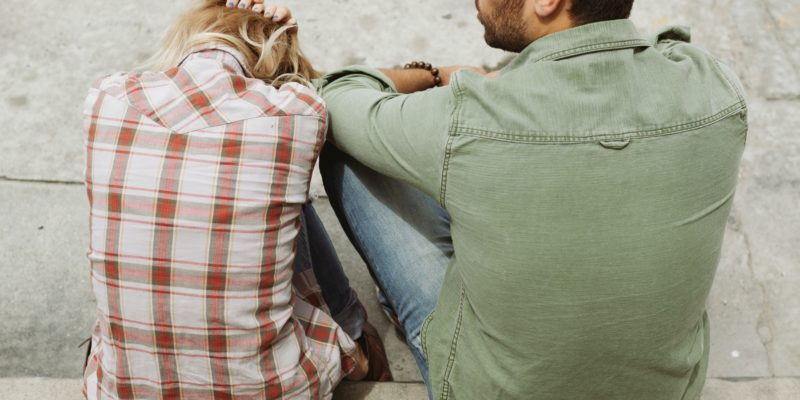 man-and-woman-sitting-on-sidewalk-226166-800x400-1